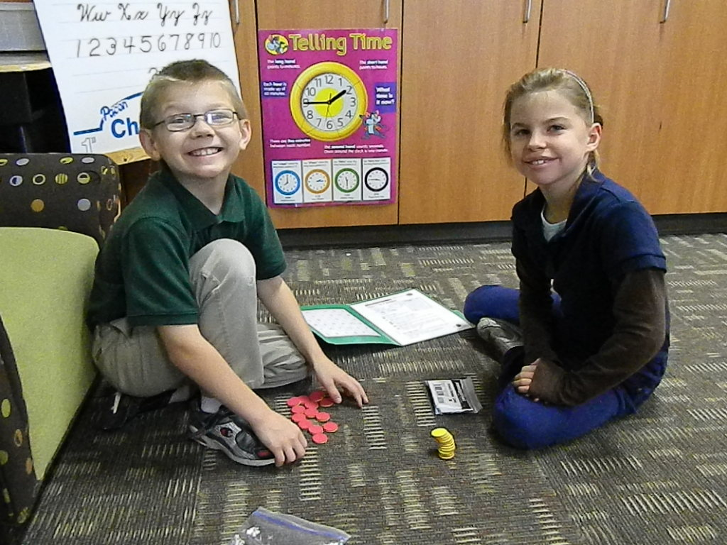 2nd grade students demonstrate math games which go home with students for more practice.