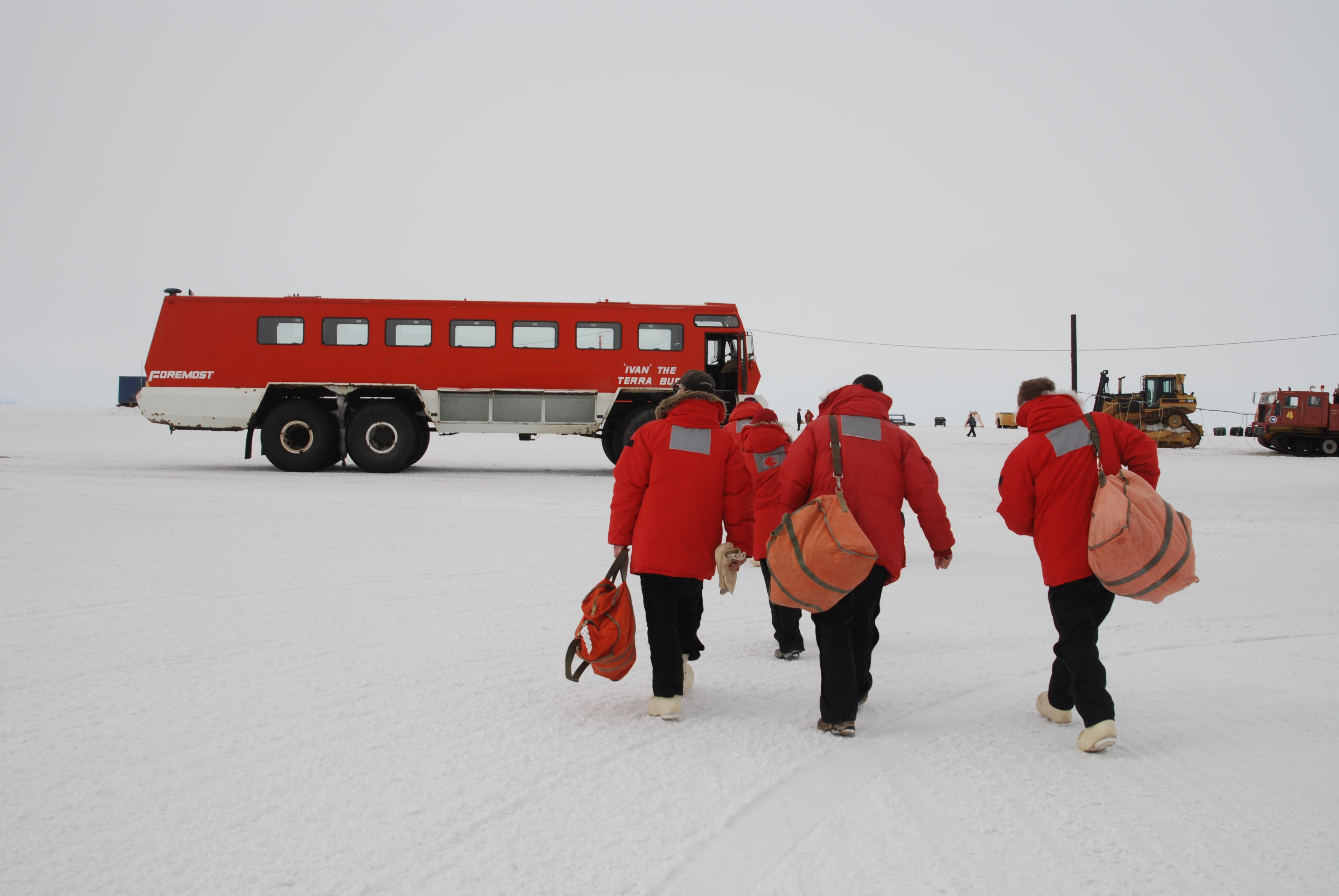 After departing the C-17 aircraft, the researchers make their way to Ivan the Terra Bus for a 30 minute shuttle ride to McMurdo Station on the Ross Sea on the southern most continent.  Photo by Kirk Beckendorf