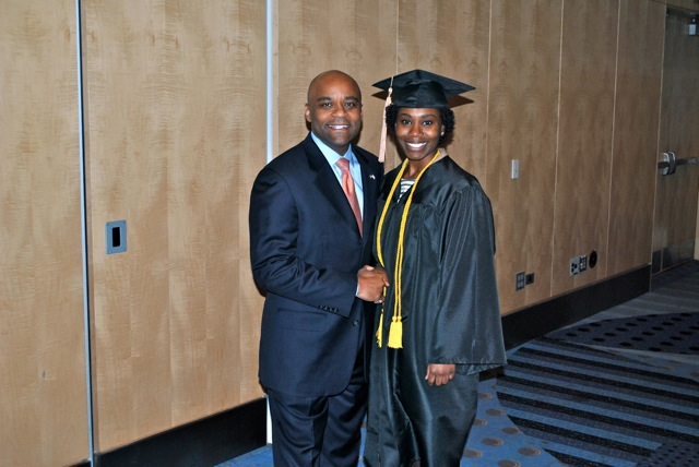 Denver Mayor Michael B. Hancock congratulates Westwood College graduate Joslyn Reese at the Dec. 16, 2011 commencement ceremony. She used her Westwood degree in construction management to get a job at CH2MHill.
