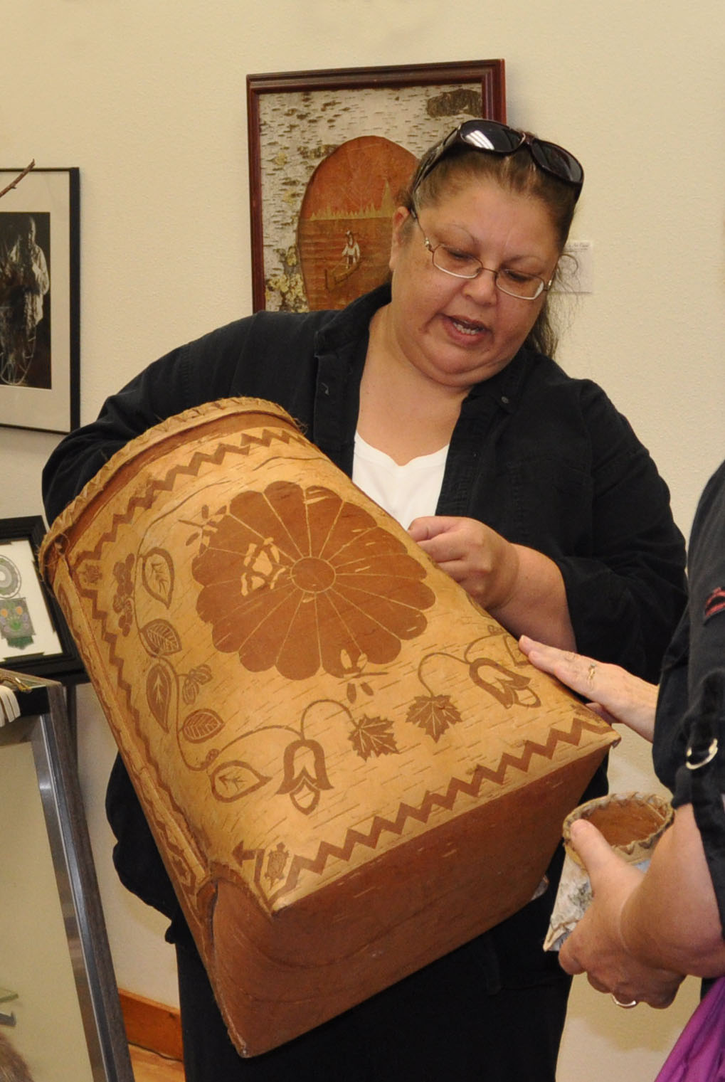 Sandra Peterson, member of the Lac du Flambeau band of Lake Superior Chippewa, makes birch bark baskets.