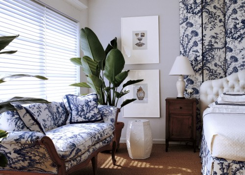 In this guest room designed by T. Keller Donovan, Hunter Douglas Silhouetter window shadings beautifully soften and diffuse the light while providing privacy.