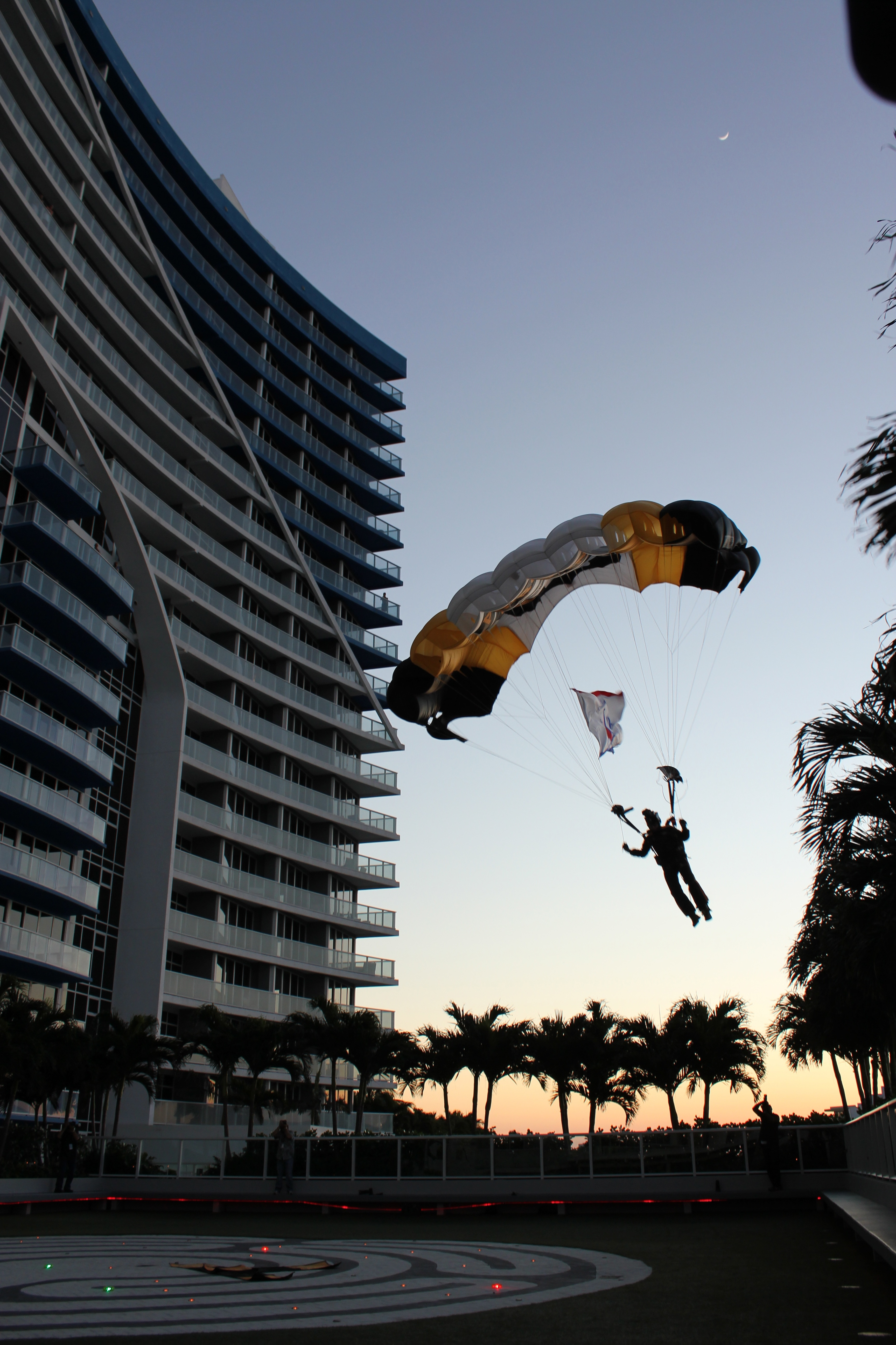 "Lauderdale Air Show Kicks off a weekend of activities with a spectacular sunset landing by a member of the 101st Airborne Division's elite parachute demonstration team at the W Fort Lauderdale. After a 5 year hiatus, ""America's Air Show"" is expected to attract 1 million visitors."