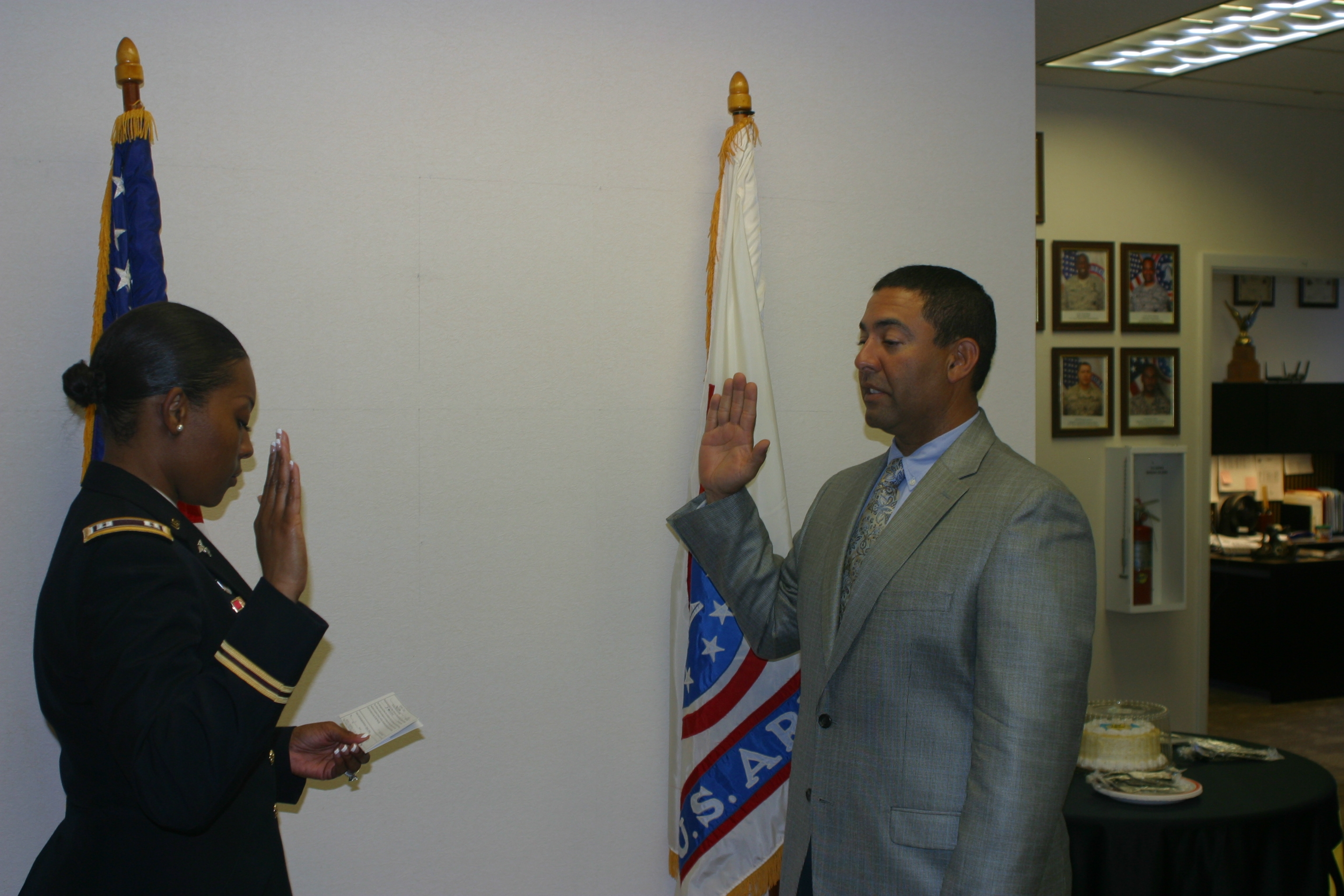 Dr. Jose Peralta being sworn in as Captain in the U.S. Army Reserves Medical Support Unit.
