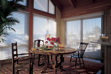 In this holiday setting, soft sheer Hunter Douglas Silhouetter window shadings on the windows work together with Luminetter Privacy Sheers on the doors to softly diffuse light.