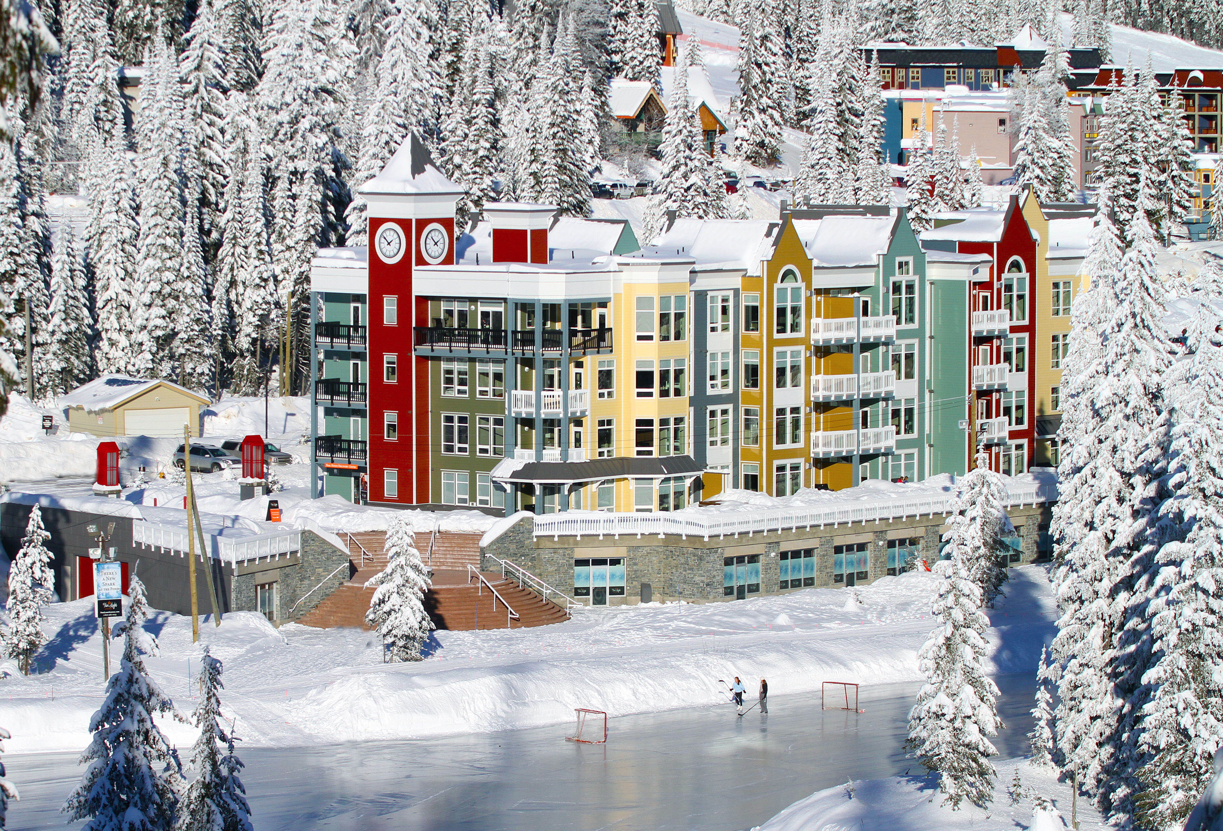 Firelight Lodge and skaters on Brewer's Pond. Photo Credit: Silver Star Mountain Resort