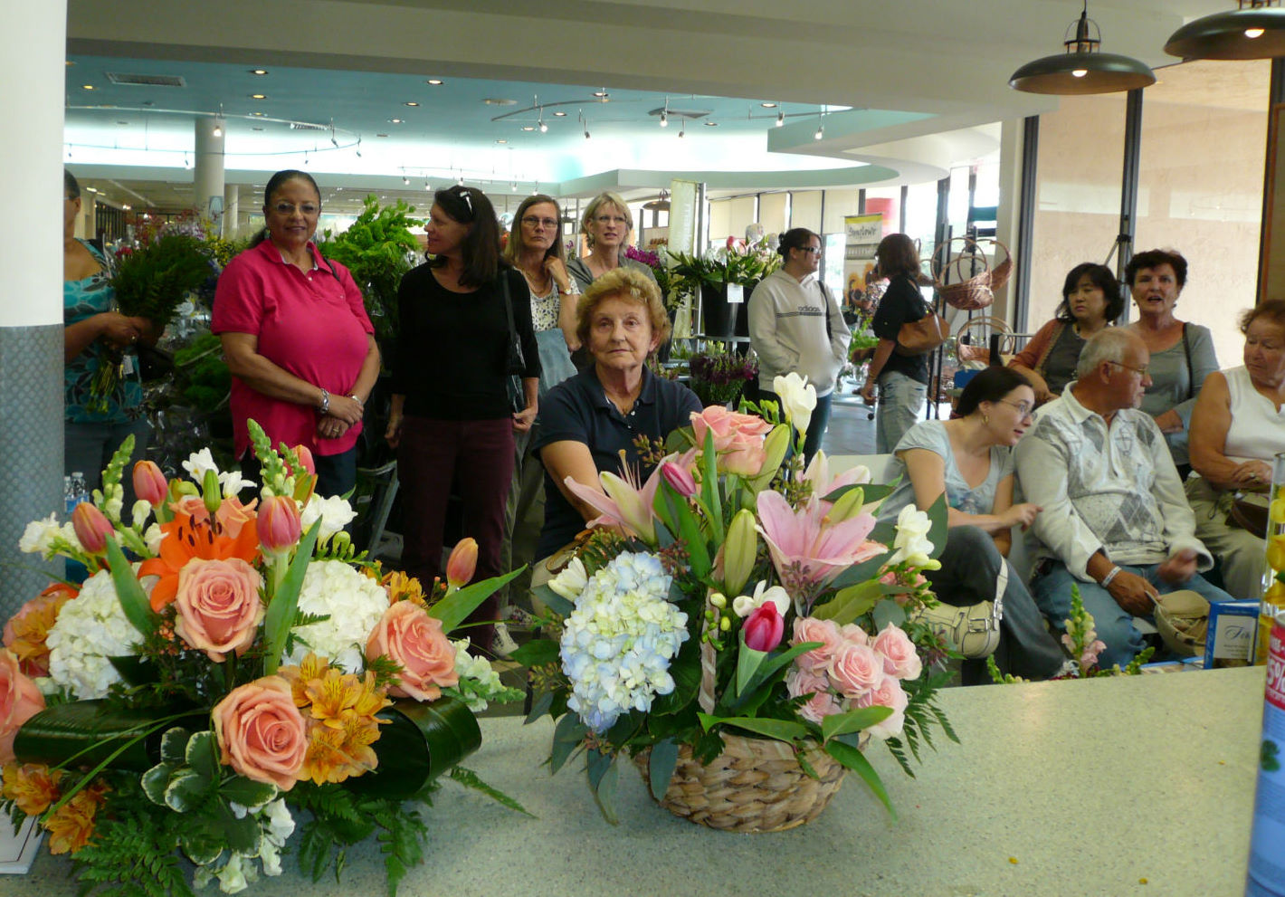 Customers enjoy a free floral demonstration