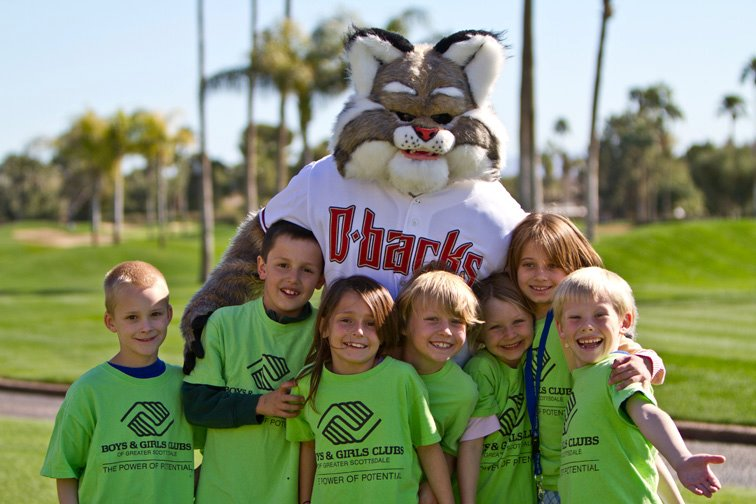 Arizona Diamondback mascot Baxter poses with kids from the Boys & Girls Club of Greater Scottsdale who benefited from the Marc Grace Celebrity Invitational on February 9 and 10.