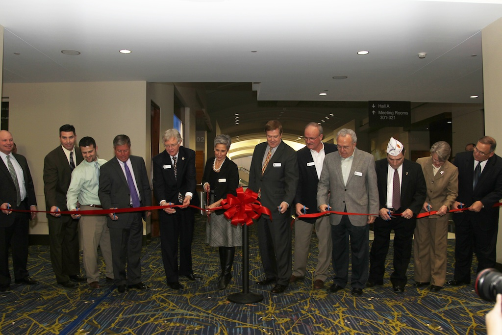 The planning team cuts the ribbon to open the renovated Veteran's Memorial Community Choice Credit Union Convention Center, created by tvsdesign.