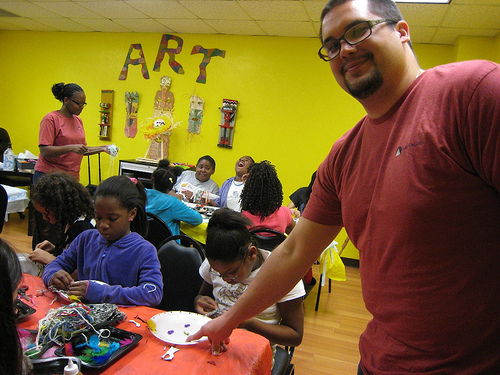 Volunteers Chris and Iddah spent time with the kids at the Plano branch Boys & Girls Club, helping a handful of girls create artistic faces on paper plates using a variety of new and recycled media