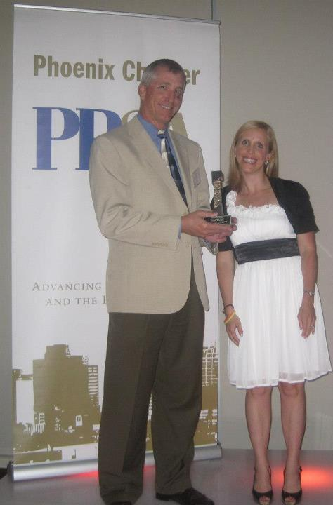 Scott Hanson accepting award from PRSA Phoenix president Christine Silverstein.