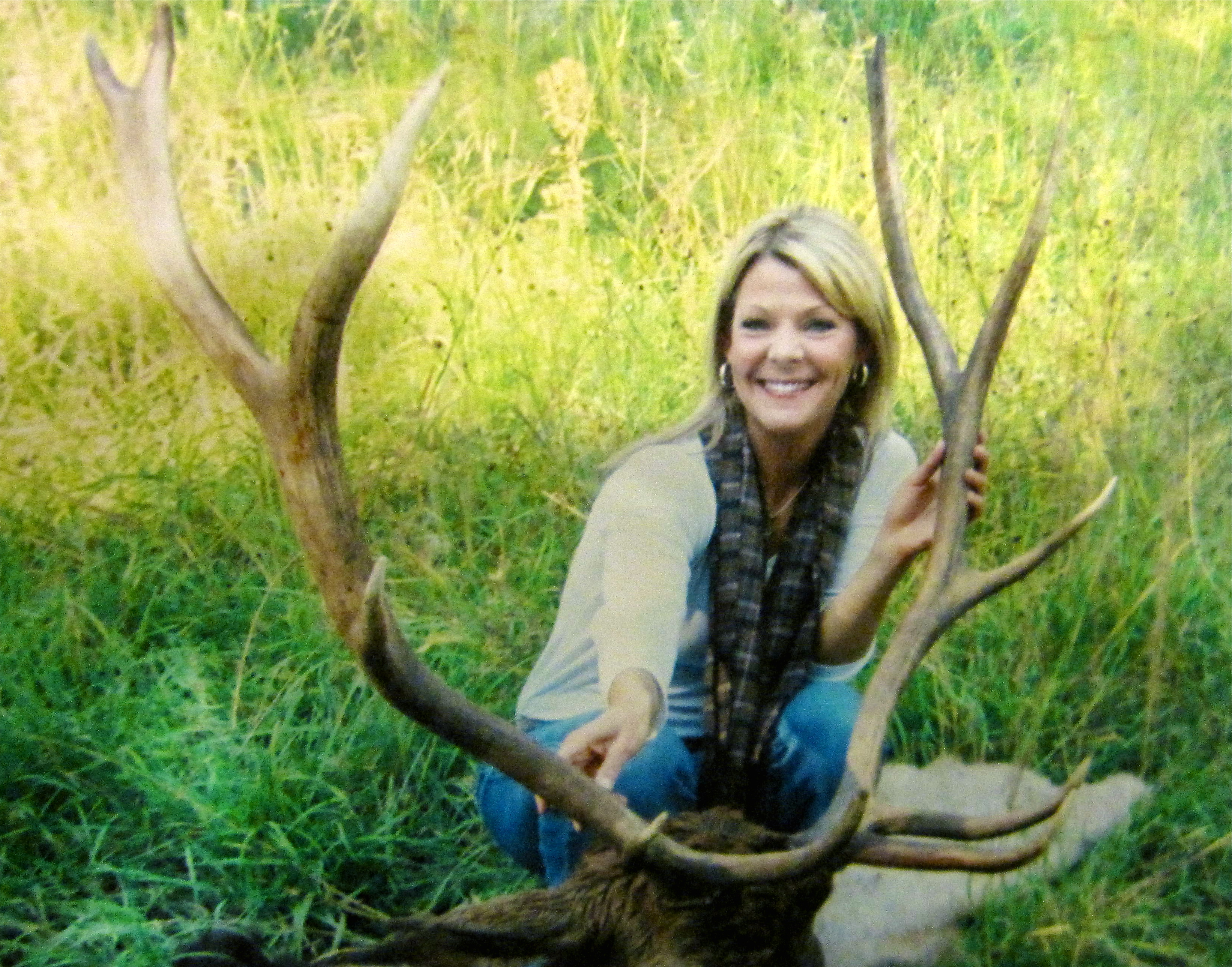 Tiffany Brewer poses with her bull elk.