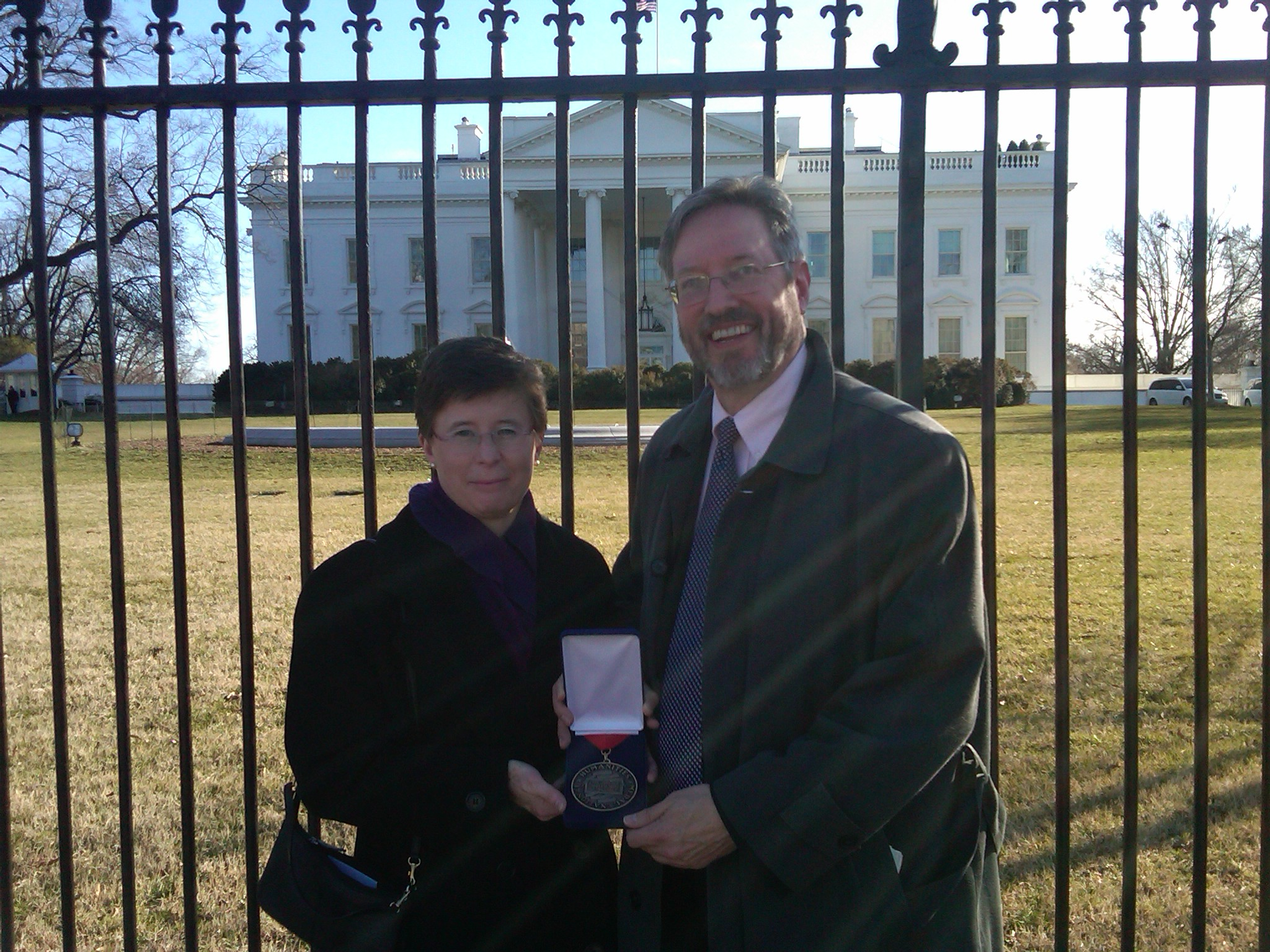 Dr. Cathy Gorn, executive director of NHD, and Ted Prasse, trustee and former chairman of the board of NHD and president of the Board of Trustees of the Ohio Historical Society, outside the White House with the National Humanities Medal, 2.13.12. 