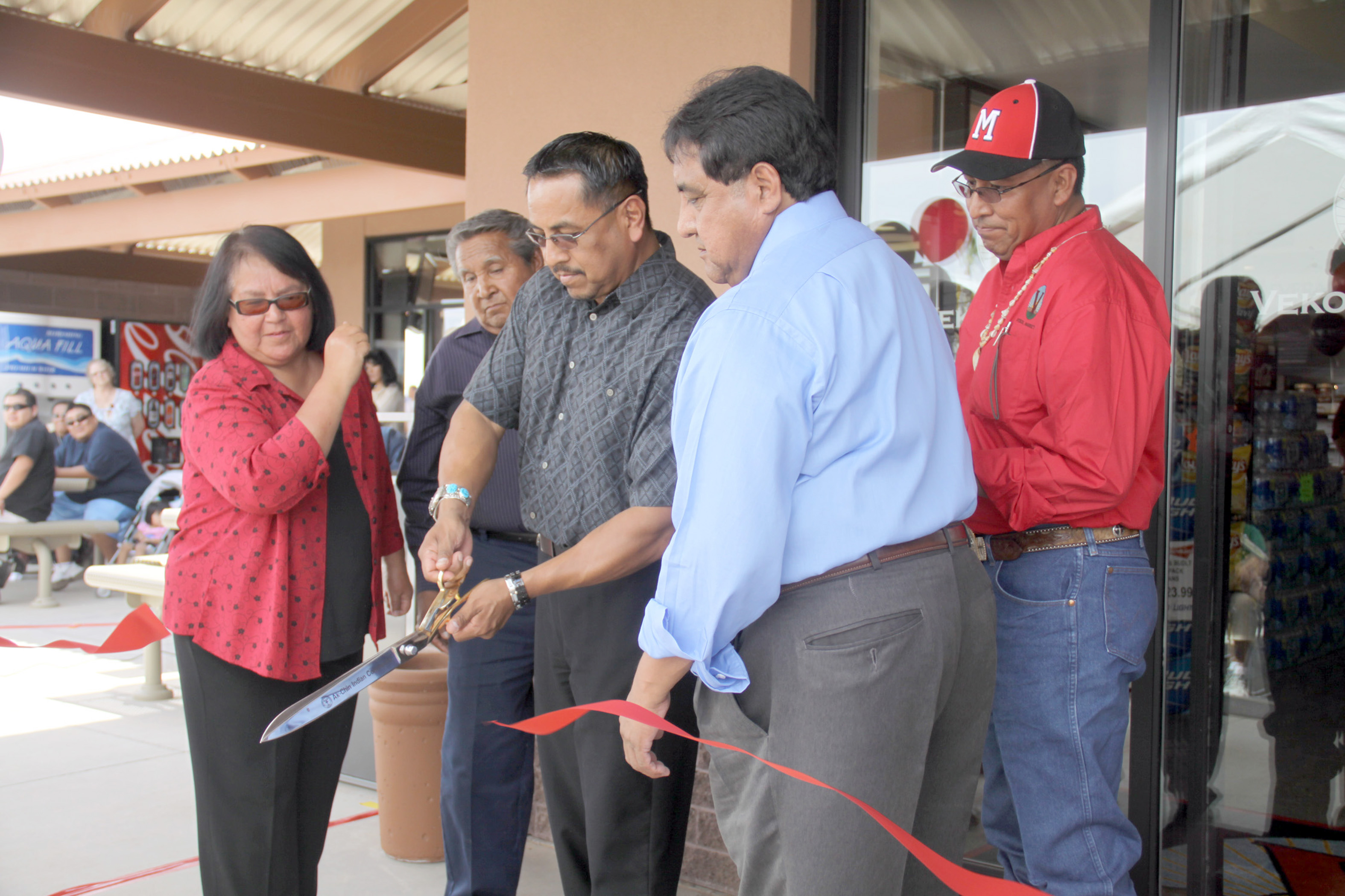 The Ak-Chin Tribal Council cutting the ribbon at the Vekol Market grand opening. From left: Delia M. Carlyle, Terry Enos, Chairman Louis Manuel Jr., Vice Chairman William J. Antone and Gabriel L. Lopez