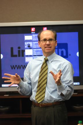 Wayne shares power tips with users during a LinkedIn training session.